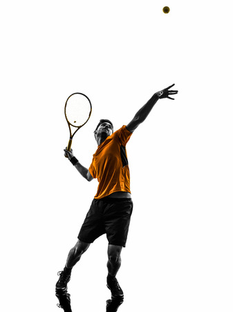Photo for one  man tennis player at service serving silhouette in silhouette on white background - Royalty Free Image