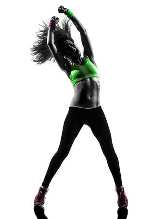 Foto de one caucasian woman exercising fitness zumba dancing  in silhouette  on white background - Imagen libre de derechos