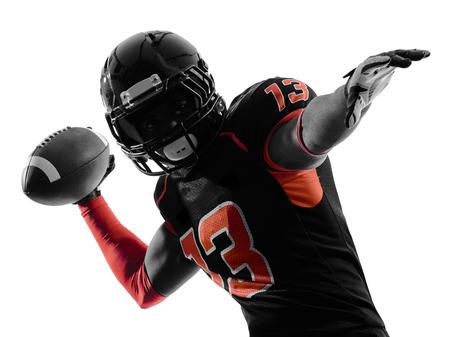 Foto de one  american football player quarterback passing portrait in silhouette shadow on white background - Imagen libre de derechos