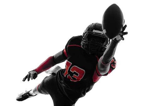 Foto de one  american football player catching ball   in silhouette shadow on white background - Imagen libre de derechos
