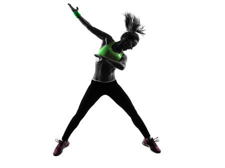 Photo for one caucasian woman exercising fitness zumba dancing jumping in silhouette  on white background - Royalty Free Image