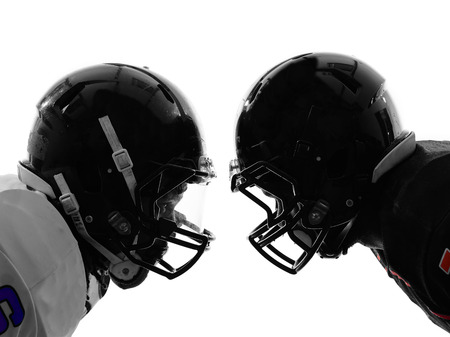 Foto de two american football players face to face in silhouette shadow on white background - Imagen libre de derechos