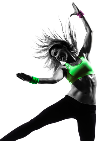 Photo for one caucasian woman exercising fitness zumba dancing in silhouette on white background - Royalty Free Image