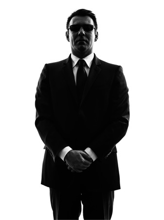 Photo for one secret service security bodyguard agent  man in silhouette  on white background - Royalty Free Image
