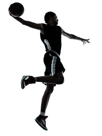 Photo for one young man basketball player one hand slam dunk silhouette in studio on white background - Royalty Free Image