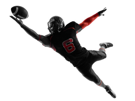 Photo pour one american football player catching ball  in silhouette shadow on white background - image libre de droit