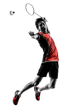 Photo for one asian badminton player young man  in silhouette isolated white background - Royalty Free Image