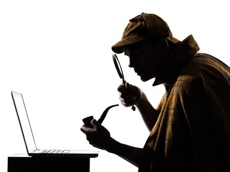 Photo for sherlock holmes laptop computer silhouette in studio on white background - Royalty Free Image