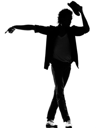 Photo for full length silhouette of a young man dancer dancing funky hip hop r&b on isolated studio white background - Royalty Free Image