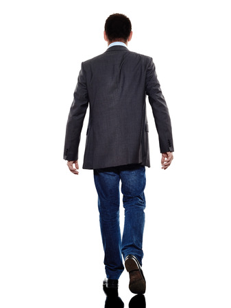 Photo for one caucasian business man walking rear view  in silhouette  on white background - Royalty Free Image