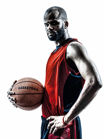 Photo for one african man basketball player holding ball in silhouette isolated white background - Royalty Free Image