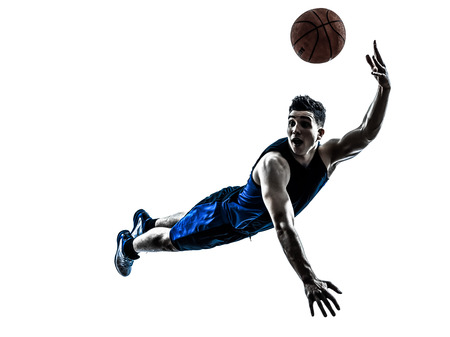 Foto de one caucasian man basketball player jumping throwing in silhouette isolated white background - Imagen libre de derechos