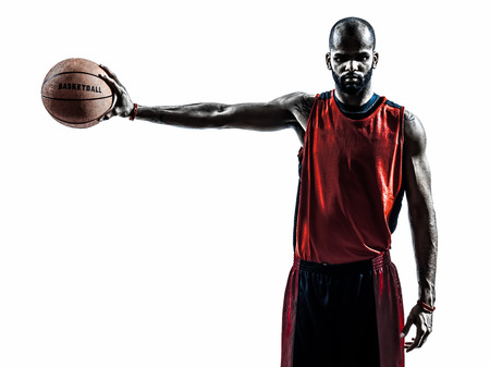 Foto de one african man basketball player holding ball in silhouette isolated white background - Imagen libre de derechos