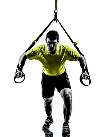 Photo for one  man exercising suspension training trx on white  - Royalty Free Image
