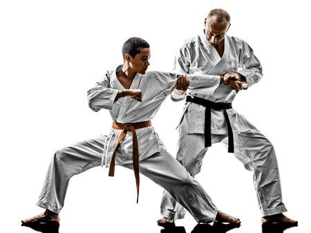 Foto de two karate men sensei and  teenager students teacher teaching isolated on white background - Imagen libre de derechos