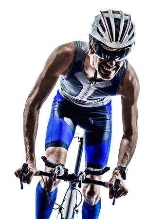 Foto de man triathlon iron man athlete bikers cyclists bicycling biking  in silhouettes on white background - Imagen libre de derechos