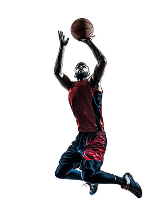 Photo pour one african man basketball player jumping throwing in silhouette isolated white background - image libre de droit