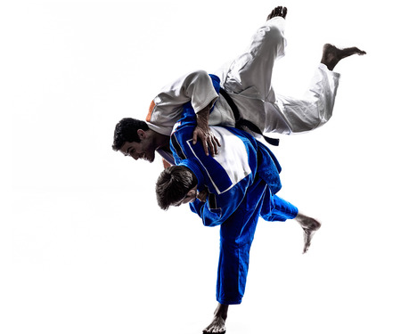 Photo for two judokas fighters fighting men in silhouette on white background - Royalty Free Image
