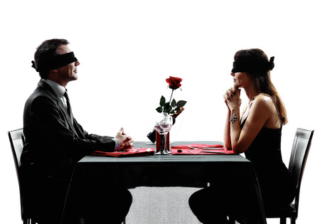 Photo pour couples lovers dinning blind date in silhouettes on white background - image libre de droit