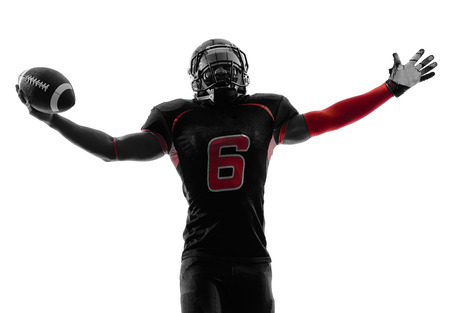 Foto de one american football player in silhouette shadow on white background - Imagen libre de derechos