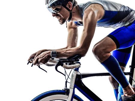 Foto de man triathlon iron man athlete biker cyclist bicycling biking in silhouette on white background - Imagen libre de derechos