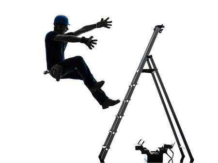 Foto de one manual worker man falling from ladder in silhouette on white background - Imagen libre de derechos