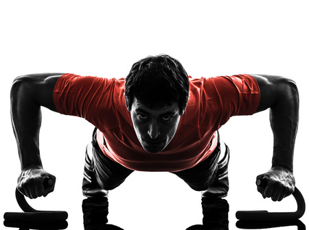 Photo pour one man exercising fitness workout push ups in silhouette on white background - image libre de droit