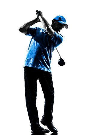 Photo pour one man golfer golfing golf swing in silhouette studio isolated on white  - image libre de droit