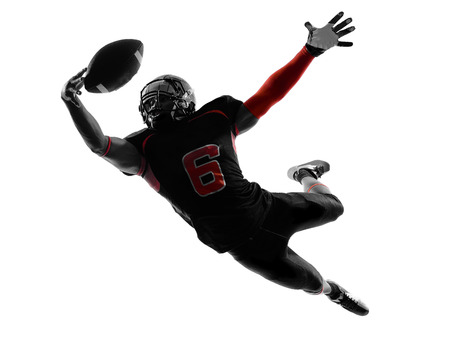 Photo for one american football player catching ball in silhouette shadow on white  - Royalty Free Image