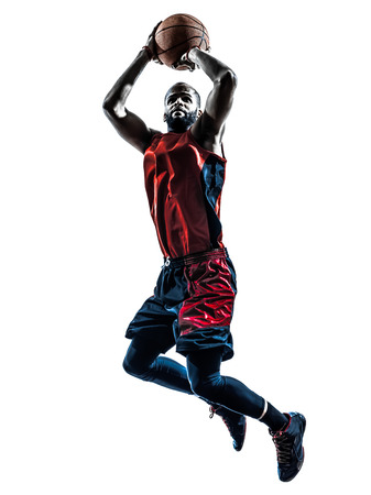 Photo pour one african man basketball player jumping throwing in silhouette isolated white  - image libre de droit