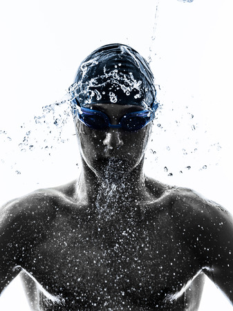Photo for one young man swimmer swimming in silhouette on white background - Royalty Free Image