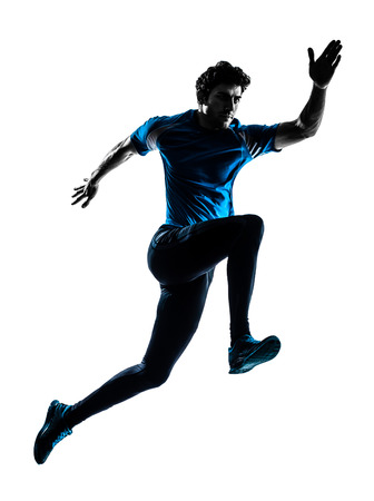 Photo pour one  man running sprinting jogging in silhouette studio isolated on white  - image libre de droit