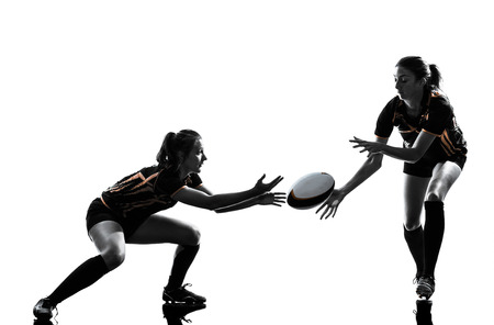 Photo pour rugby women players team in silhouette isolated on white backround - image libre de droit