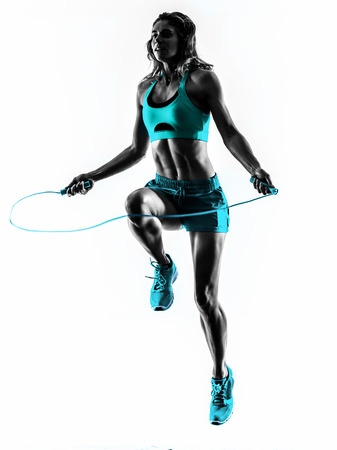 Photo for one caucasian woman exercising  Jumping Rope fitness in studio silhouette isolated on white background - Royalty Free Image