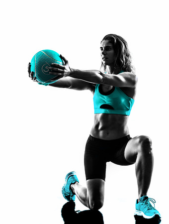 Foto de one caucasian woman exercising Medicine Ball  fitness in studio silhouette isolated on white background - Imagen libre de derechos