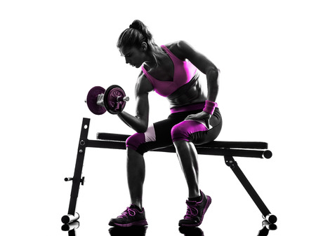 Photo pour one caucasian woman exercising   weights body building fitness in studio silhouette isolated on white background - image libre de droit