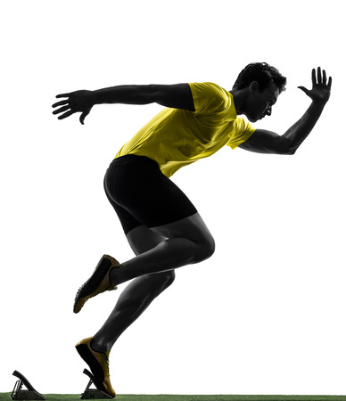 Photo pour one  man young sprinter runner in starting blocks silhouette studio on white background - image libre de droit