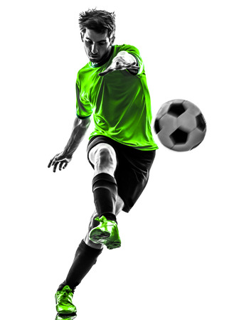Photo for one soccer football player young man kicking in silhouette studio on white background - Royalty Free Image