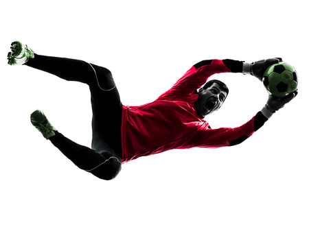 Photo for one  soccer player goalkeeper man catching ball in silhouette isolated white background - Royalty Free Image