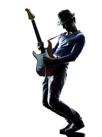 Photo for one caucasian man electric guitarist player playing in studio silhouette isolated on white background - Royalty Free Image