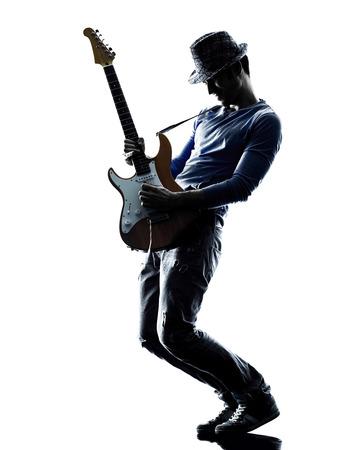 Foto de one caucasian man electric guitarist player playing in studio silhouette isolated on white background - Imagen libre de derechos