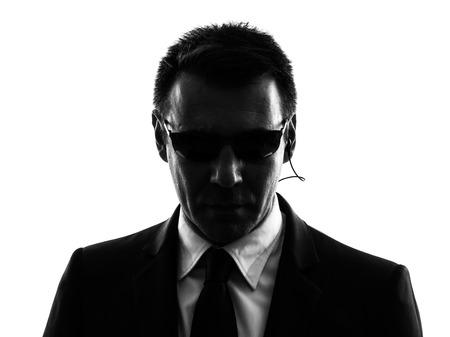 Photo pour one secret service security bodyguard agent man in silhouette on white background - image libre de droit