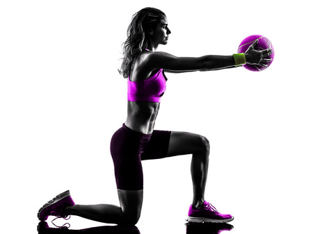 Photo pour one caucasian woman exercising Medicine Ball  fitness in studio silhouette isolated on white background - image libre de droit