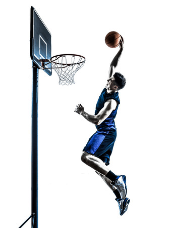 Foto de one  man basketball player jumping dunking in silhouette isolated white background - Imagen libre de derechos