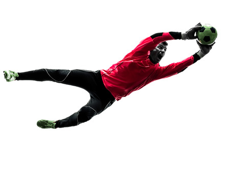 Photo pour one  soccer player goalkeeper man catching ball in silhouette isolated white background - image libre de droit