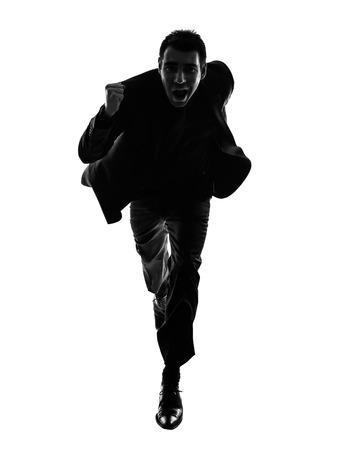 Foto de one caucasian business man running in silhouette on white background - Imagen libre de derechos