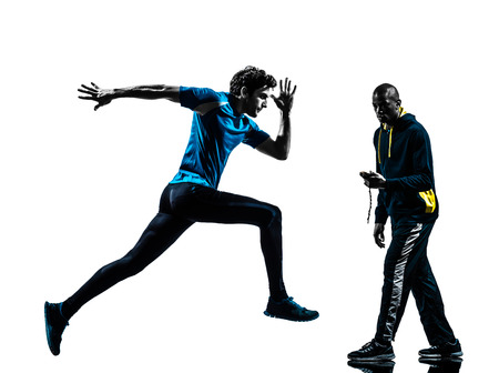 Photo for one  man running sprinting with coach stopwatch in silhouette studio isolated on white background - Royalty Free Image
