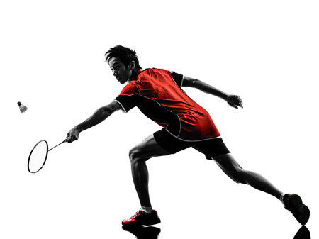 Foto per one asian badminton player young man in silhouette isolated white background - Immagine Royalty Free