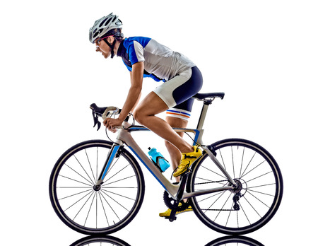Foto de woman triathlon ironman athlete  cyclist cycling on white background - Imagen libre de derechos