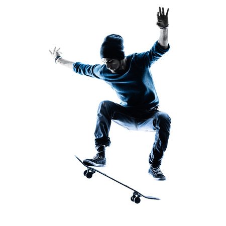 Photo pour one caucasian man skateboarder skateboarding  in silhouette isolated on white background - image libre de droit